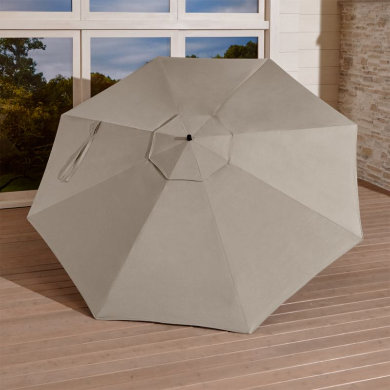 A smart neutral stone umbrella cover of Sunbrella® acrylic fabric blocks out 98% of the sun's UV rays. Fits our 10' Round Free-Arm Umbrella Frame with Base (sold separately).<br /><br /><NEWTAG/><ul><li>Fade- and mildew-resistant Sunbrella acrylic</li><li>Made in USA</li></ul>