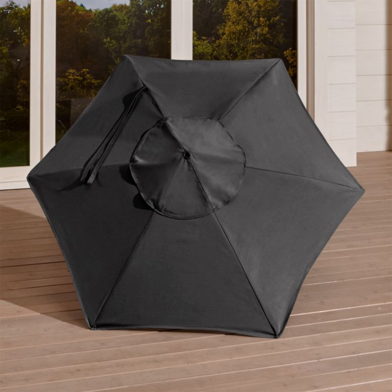 "A chic charcoal canopy in fade- and mildew-resistant Sunbrella® acrylic blocks out 98% of the sun's rays. Fits our 6' round frames. For frame and stand options with this cover, see below (frames and stands sold separately).<br /><br /><NEWTAG/><ul><li>Cover: fade- and mildew-resistant Sunbrella acrylic umbrella (fits our 6' round frames; spot clean)</li><li>Frames (sold separately): aluminum tilt with black finish; 90""H for dining table or 94""H for high dining table</li><li>Stands (sold separately): rustproof poly resin and stone-polyester mixture, in charcoal finish</li><li>Small stand accommodates all our aluminum umbrella frames and 9' round eucalyptus frame</li><li>Use large stand with any of our umbrella frames: accommodates 1.5""dia. frame with adapter, or 1.875""dia. frame without adapter (adapter included)</li><li>Large stand works with a table or on its own</li><li>Made in USA</li></ul>"