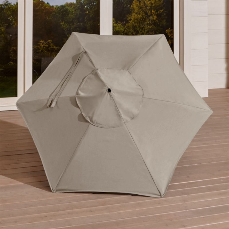 """A neutral stone canopy in fade- and mildew-resistant Sunbrella® acrylic blocks out 98% of the sun's rays. Fits our 6' round frames. For frame and stand options with this cover, see below (frames and stands sold separately).<br /><br /><NEWTAG/><ul><li>Cover: fade- and mildew-resistant Sunbrella acrylic umbrella (fits our 6' round frames; spot clean)</li><li>Frames (sold separately): aluminum tilt with black finish; 90""""H for dining table or 94""""H for high dining table</li><li>Stands (sold separately): rustproof poly resin and stone-polyester mixture, in charcoal finish</li><li>Small stand accommodates all our aluminum umbrella frames and 9' round eucalyptus frame</li><li>Use large stand with any of our umbrella frames: accommodates 1.5""""dia. frame with adapter, or 1.875""""dia. frame without adapter (adapter included)</li><li>Large stand works with a table or on its own</li><li>Made in USA</li></ul>"""