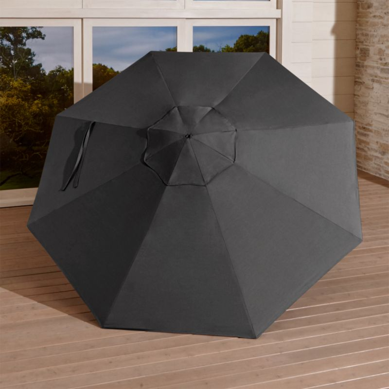 A chic charcoal canopy in fade- and mildew-resistant Sunbrella® acrylic blocks out 98% of the sun's rays. Fits all of our 9' round frames. For frame and stand options with this cover, see below (frames and stands sold separately).<br /><br /><NEWTAG/><ul><li>Fade- and mildew-resistant Sunbrella acrylic umbrella (fits all 9' round frames; spot clean)</li><li>Frames (sold separately): adjustable FSC-certified eucalyptus with solid brass pulley; or aluminum tilt with silver or black finish</li><li>Stands (sold separately): rustproof resin and stone-polyester mixture, in charcoal finish.</li><li>Made in USA or China</li></ul><br />