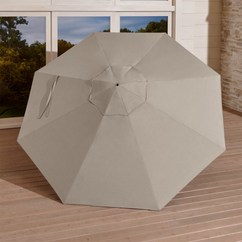 In chic neutral stone, this Sunbrella acrylic canopy resists fading and mildew as it blocks out 98% of the sun's rays. Fits all of our 9' round frames. The 9' Round Sunbrella Stone Outdoor Umbrella Canopy is a Crate and Barrel exclusive.<br /><br /><NEWTAG/><ul><li>Fade- and mildew-resistant Sunbrella acrylic (fits all 9' round frames)</li><li>Frames (sold separately): adjustable FSC-certified eucalyptus with solid brass pulley; or aluminum tilt with silver or black finish</li><li>Stands (sold separately): rustproof resin and stone-polyester mixture, in charcoal finish.</li><li>Made in USA or China</li></ul>