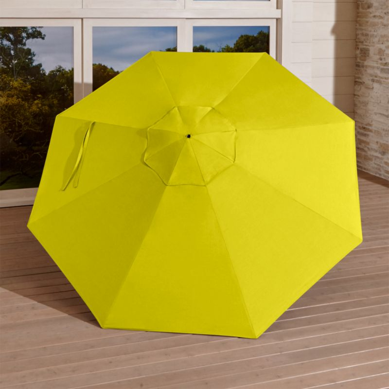 Arching over our outdoor dining furniture, this bright sulfur yellow canopy is tailored in fade- and mildew-resistant Sunbrella acrylic to block out 98% of the sun's rays. Fits all of our 9' round frames. The 9' Round Sunbrella Sulfur Outdoor Umbrella Canopy is a Crate and Barrel exclusive.<br /><br /><NEWTAG/><ul><li>Fade- and mildew-resistant Sunbrella acrylic (fits all 9' round frames)</li><li>Frames (sold separately): adjustable FSC-certified eucalyptus with solid brass pulley; or aluminum tilt with silver or black finish</li><li>Stands (sold separately): rustproof resin and stone-polyester mixture, in charcoal finish.</li><li>Made in USA or China of domestic and imported materials</li></ul>