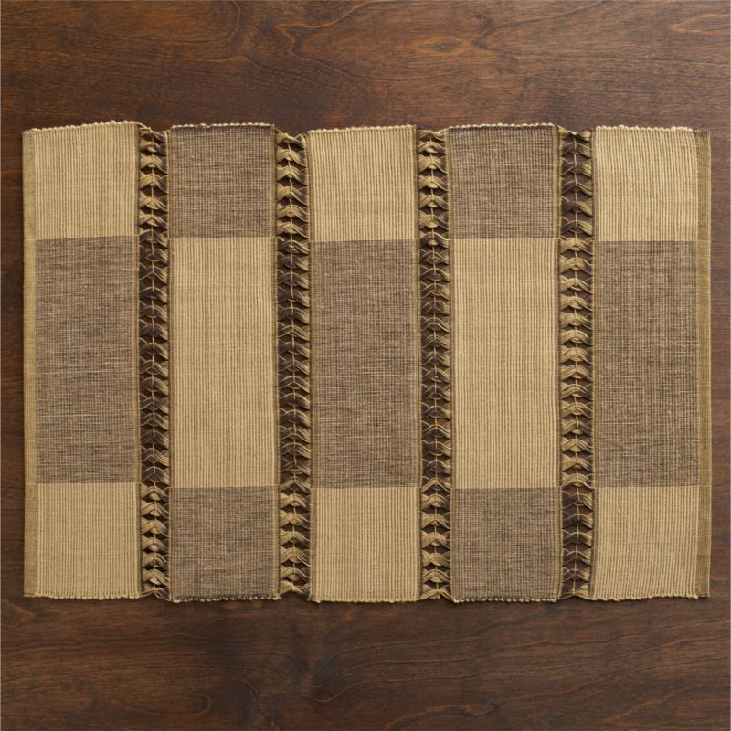 Soft-spoken backdrop for a casual place-setting has the look of rattan. Handwoven ribbed cotton panels in alternating earth-tone color blocks are joined in a hand-tied open twist weave.<br /><br /><NEWTAG/><ul><li>Handcrafted</li><li>100% cotton</li><li>Machine wash, reshape and dry flat; warm iron as needed</li><li>Do not dry clean</li><li>Made in India</li></ul>