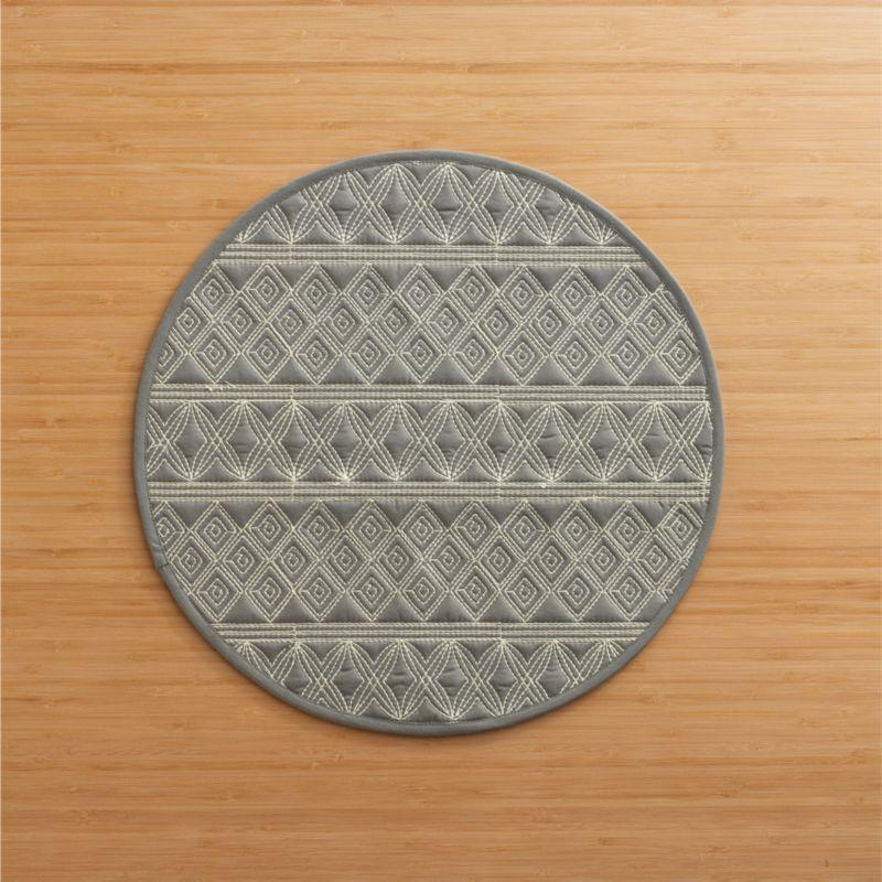 Embroidered geometric patterns quilt fine-lined graphics on grey cotton round. Scaled-down size is great smaller tables.<br /><br /><NEWTAG/><ul><li>100% cotton</li><li>100% polyester filling</li><li>Machine wash, line dry</li></ul>