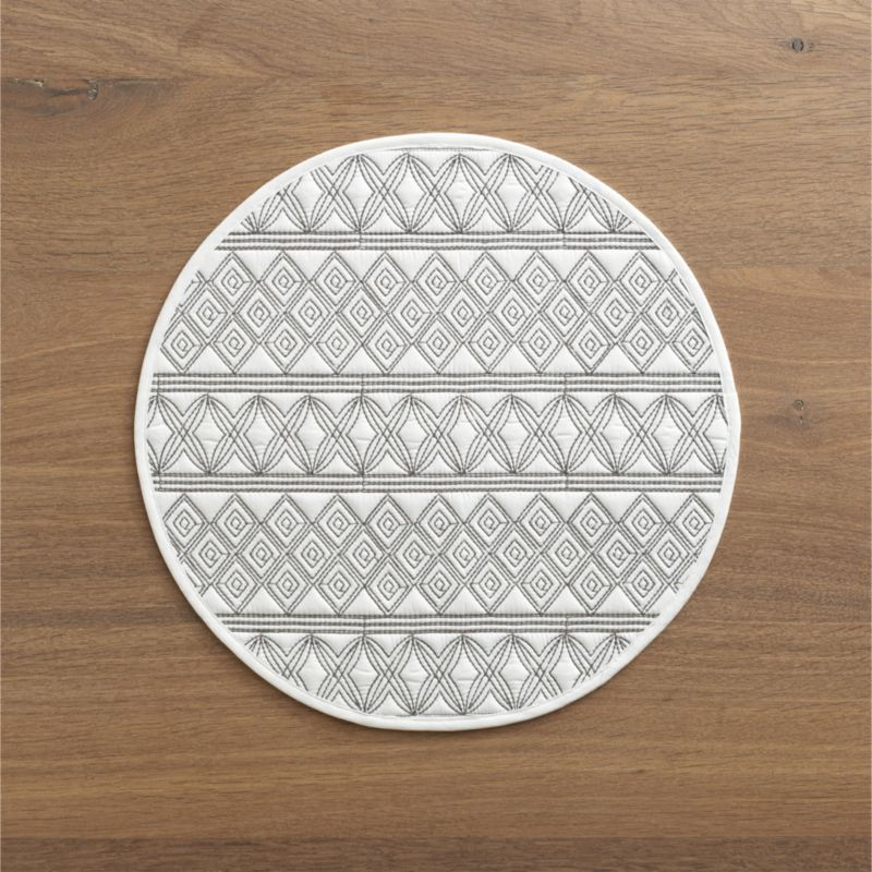 Embroidered geometric patterns quilt fine-lined graphics on white cotton round. Scaled-down size is great smaller tables.<br /><br /><NEWTAG/><ul><li>100% cotton</li><li>100% polyester filling</li><li>Machine wash, line dry</li></ul>