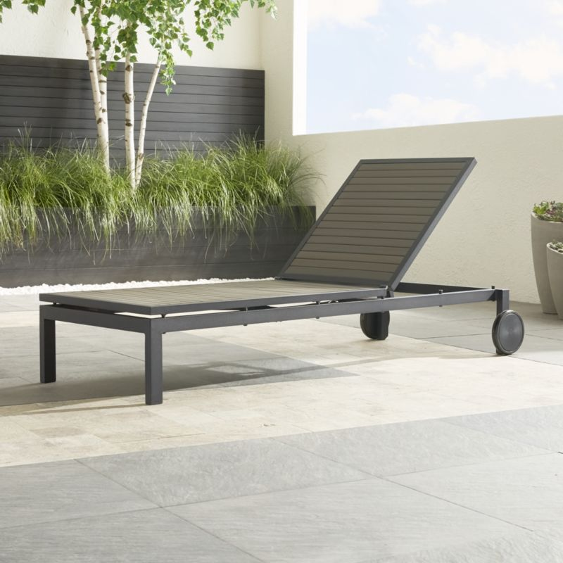 Follow the sun or shade with the casual and stylish Alfresco outdoor chaise lounge. Fooling the eye with its real wood appearance as it fools the elements with water-, UV- and fade-resistant properties, this sleek chaise in warm grey slatted polystyrene faux wood is treated with UV and anti-oxidant protection. <NEWTAG/><ul><li>Extruded polystyrene with UV and anti-oxidant protection</li><li>Aluminum frame with powdercoat finish</li><li>Adjusts to any position with gas-lift mechanism</li><li>2 rear wheels</li><li>Made in China</li></ul>