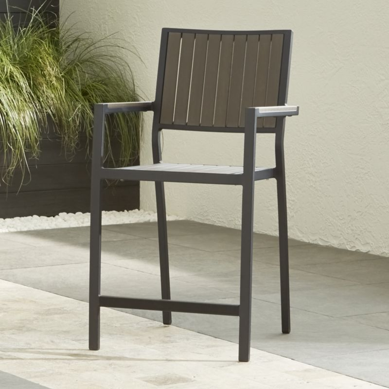 "This casual and stylish counter stool from our Alfresco outdoor dining collection fools the eye with the look of real wood while fooling the elements with water- UV- and fade-resistant qualities. <NEWTAG/><ul><li>Extruded polystyrene with UV and anti-oxidant protection</li><li>Aluminum frame with powdercoat finish</li><li>Stacks up to 4 high for easy storage</li><li>24""H seat sized for counters or Alfresco High Dining Table</li><li>Made in China</li></ul><br />"