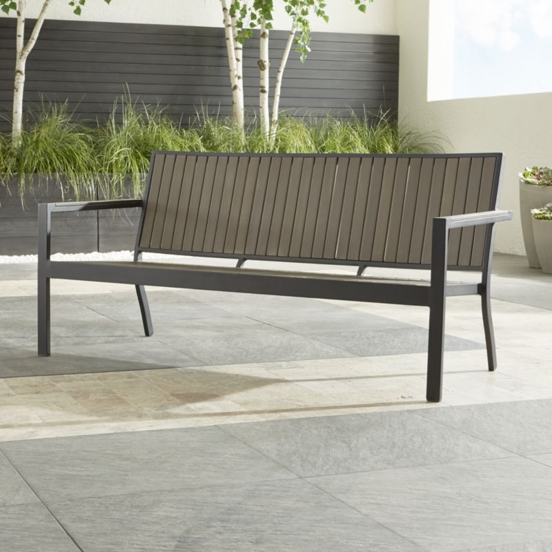 Park-bench style contemporary seating that fools the eye with the look of real wood while fooling the elements with waterproof and fade-resistant qualities. Our casual and stylish Alfresco outdoor sofa features a clean slatted design in innovative polystyrene faux wood. Warm grey slats look sleek against the lightweight, black powdercoated aluminum frame. The Alfresco Grey Outdoor Sofa is a Crate and Barrel exclusive.<br /><br /><NEWTAG/><ul><li>Extruded polystyrene with UV and anti-oxidant protection</li><li>Aluminum frame with powdercoat finish</li><li>Stacks up to 4 high for easy storage</li><li>Seats up to 3</li><li>Made in China</li></ul>