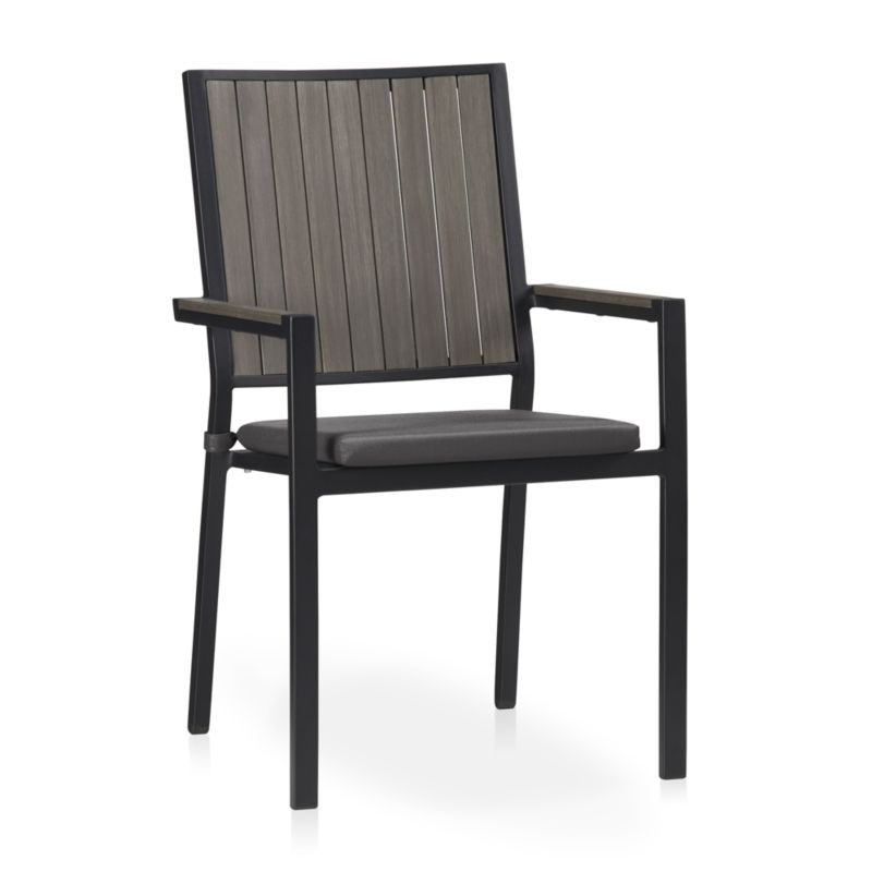 Casual and stylish, our stackable Alfresco outdoor dining chair fools the eye with the look of real wood and fools the elements with UV- and fade-resistant qualities for outdoor living. Slats of innovative warm grey polystyrene faux wood are treated with UV and anti-oxidant protection. <NEWTAG/><ul><li>Extruded polystyrene with UV and anti-oxidant protection</li><li>Aluminum frame with powdercoat finish</li><li>Fade- and mildew-resistant Sunbrella acrylic cushion</li><li>Foam cushion fill</li><li>Fabric tab fasteners</li><li>Stacks up to 4 high for easy storage</li><li>Made in China and USA</li></ul><br /><br />