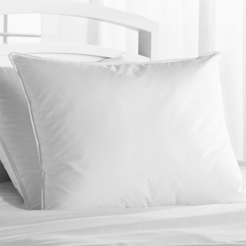 Down-like yet down-free, our plump, hypoallergenic down alternative pillows are encased in 230-thread-count cambric cotton and filled with Italian-crafted synthetic microfiber clusters, developed to closely resemble the feel of the real thing. <a href=/feather-down-bed-pillows/f11504>Feather-Down Bed Pillows</a> and <a href=/premium-down-bed-pillows/f58248>Premium Down Bed Pillows</a> also available.<br /><br /><NEWTAG/><ul><li>100% cambric cotton cover</li><li>Microfiber cluster fill, 19 oz.</li><li>Sized to fit our pillowcases</li><li>Machine wash in warm water, like colors, no bleach</li><li>Tumble dry, medium heat until thoroughly dry</li><li>For best results, professional laundering is recommended</li><li>Do not dry clean</li><li>Made in multiple countries of domestic and imported materials</li></ul>
