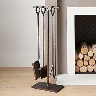 Hammered texture, traditional looped handles and a warm antiqued brass finish lend rustic appeal to our simply styled fireplace poker, brush and shovel handcrafted of wrought and sheet iron.