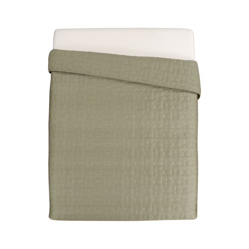Our sumptuous take on fine bedding tracks modern in soft sateen cotton stitched in a crisp geometric repeat. Quilt reverses to cotton sheeting for sleeping comfort. A knockout used solo, Anujah layers beautifully with prints and contrasting solids, smooth or textured fabrics.<br /><br /><NEWTAG/><ul><li>100% cotton sateen</li><li>Reverses to 100% cotton</li><li>100% polyester fill</li><li>Dry clean</li></ul>