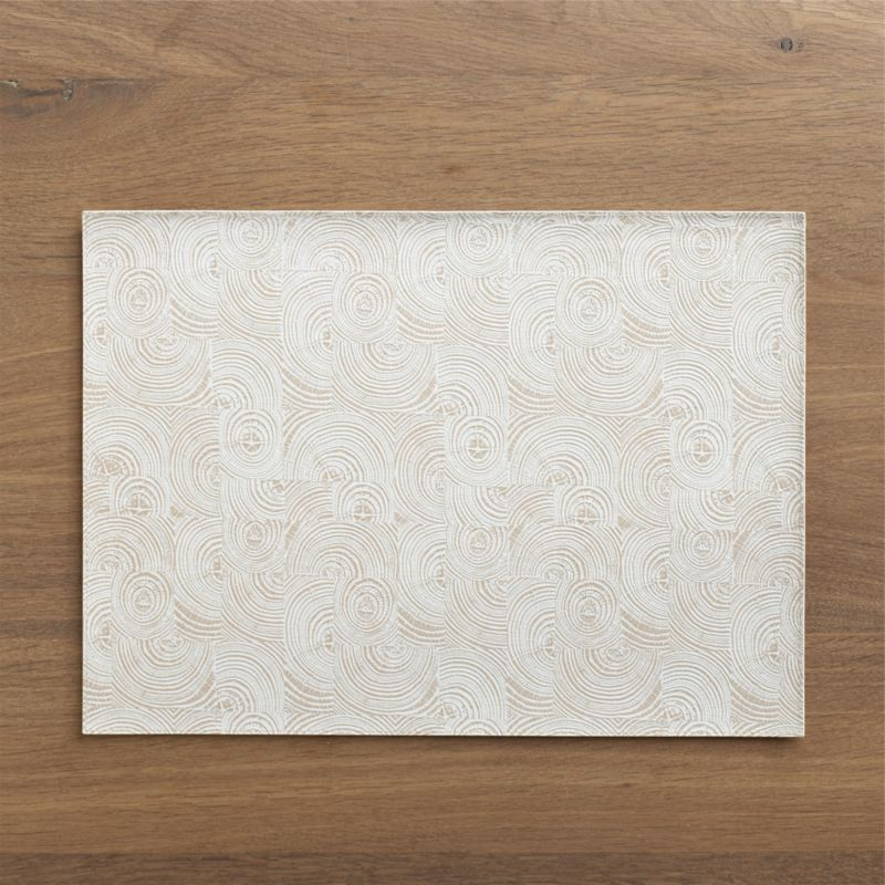 Ivory impressions of cross-cut trees form an organic tabletop graphic in easy-clean, textured faux leather. Flocked backing protects table surfaces from scratches and spills.<br /><br /><NEWTAG/><ul><li>100% PVC faux leather</li><li>Flocked polyamide backing</li><li>Clean with a damp cloth</li><li>Made in Turkey</li></ul>