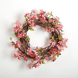 Cheerful pink apple blossoms craft a faux wreath that will brighten each day with the fresh colors of springtime.