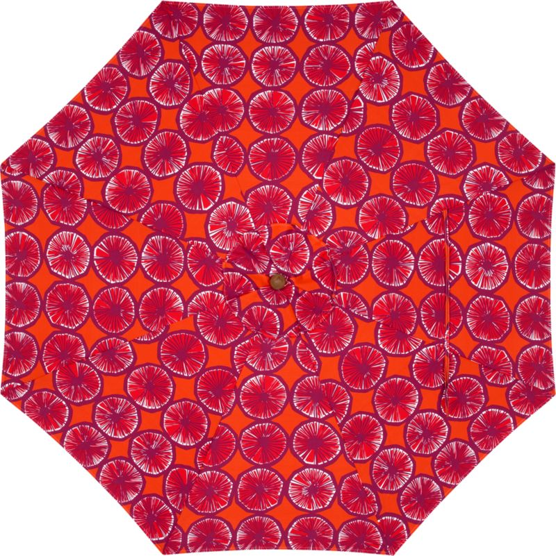 """The Appelsiini caliente umbrella canopy is made of weather- and UV-resistant Spun Polyester. Designed in 1950, Appelsiini (""""orange"""") represents one of the first patterns created by legendary Marimekko designer Maija Isola. Steeped in rich color and deliberate detail, linear rows of orange slices are abundant in graphic repetition. With painting supplies scarce in the early 1950s, Maija experimented with crayons to achieve similar color saturation. Drawing patterns on thin sheets of paper, she would dampen them on a wooden board, allowing the hues to deepen and permeate the page in a painterly effect. Appelsiini represents this unconventional method. Fits all of our 9' round frames. (Frames and stands sold separately).<br /><br /><NEWTAG/><ul><li>Pattern designed by Maija Isola; early 1950s</li><li>Cover: Weather- and UV-resistant Spun Polyester (fits all 9' round frames; spot clean)</li><li>Made in Indonesia</li></ul><br />"""