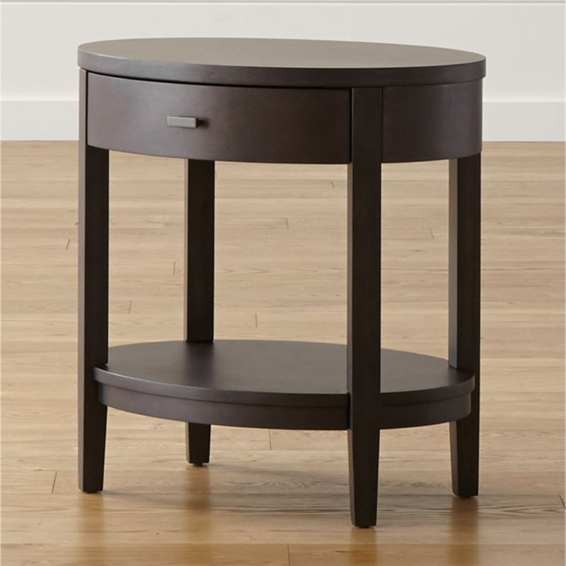 Dressed in deep charcoal with an elegant oval shape echoed in a bow-front drawer, our Arch nightstand modernizes classic cottage styling without sacrificing an ounce of charm. <NEWTAG/><ul><li>Designed by Blake Tovin of Tovin Design</li><li>Poplar, birch veneer and engineered wood with with lacquer finish over charcoal glaze</li><li>Metal hardware with matte pewter finish</li><li>1 drawer with  metal side-mounted drawer glides</li><li>Levelers</li><li>Made in Vietnam</li></ul>
