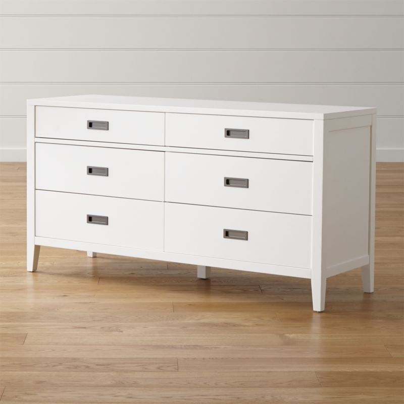 Designed by Blake Tovin, our Arch bedroom collection modernizes classic cottage styling without sacrificing an ounce of charm. Freshly dressed in crisp white, the 6-drawer dresser has a lean, solid poplar frame subtly outlined with a trim divider between the upper 2 and lower 4 drawers. <NEWTAG/><ul><li>Designed by Blake Tovin of Tovin Design</li><li>Solid poplar and engineered wood with lacquer finish over white sealer</li><li>Naturally expands and contracts with changes in humidity</li><li>Antique brass hardware</li><li>Metal side-mounted  glides</li><li>Levelers</li><li>Made in Vietnam</li></ul><br />