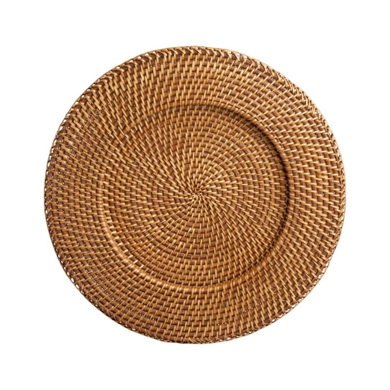 A honey brown finish warms this handcrafted rattan charger-platter. Each is made with a fine, tight weave for sturdy serving.<br /><br /><NEWTAG/><ul><li>Handwoven rattan</li><li>Honey brown finish</li><li>Foodsafe lacquer finish</li><li>Liner recommended to extend wear</li><li>Clean with a dry cloth</li><li>Made in The Philippines</li></ul>