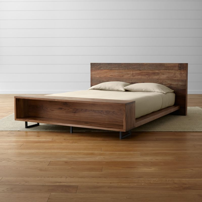 "Atwood's eclectic nature mixes rustic reclaimed peroba wood from Brazil with refined solid American black walnut. Uniquely weathered planks of wood showcase distinctive variations in texture and tone, blending contemporary design with rustic materials for an earthy look that's modern and bold. <NEWTAG/><ul><li>Reclaimed peroba wood headboard with natural beeswax finish</li><li>Solid black walnut side rails, footboard, and headboard back with lacquer finish</li><li>Iron legs with lacquer topcoat</li><li>As with all solid woods, expansion and contraction may occur with seasonal changes in humidity</li><li>Dovetail joinery on footboard</li><li>11 slats and 2 center support legs</li><li>Platform bed designed for use with mattress only</li><li><a href=""/furniture/mattresses-foundations/1"">Mattresses</a> available (sold separately)</li><li>Maximum weight capacity: 800 pounds (includes weight of mattress and occupants)</li><li>Made in Mexico</li></ul>"