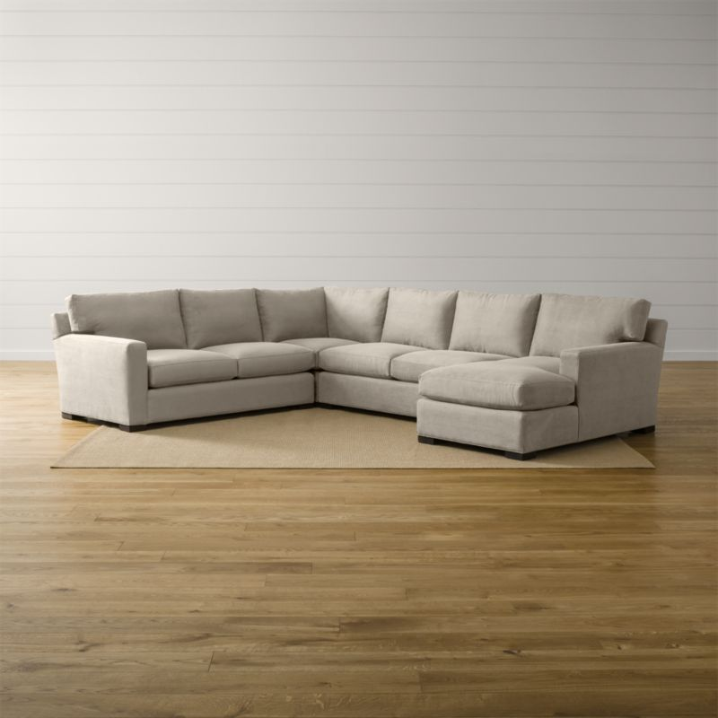 Bring Axis home and watch life revolve around it. Upholstered in a high-performance fabric that's pet, kid, and family friendly, this collection offers exceptional durability for family rooms and casual living rooms—and the versatility to customize your ideal sectional. This 4-piece sectional is comprised of the left arm apartment sofa, loveseat, right arm chaise and corner. <NEWTAG/><ul><li>Frames are benchmade with certified sustainable hardwood that's kiln-dried to prevent warping</li><li>Flexolator spring suspension systems</li><li>Soy-based polyfoam seat cushions wrapped in fiber-down blend and encased in downproof ticking</li><li>Fiber-down back cushions encased in downproof ticking</li><li>Hardwood legs stained with a rich brown finish</li><li>Made in North Carolina, USA of domestic and imported materials</li></ul><br />