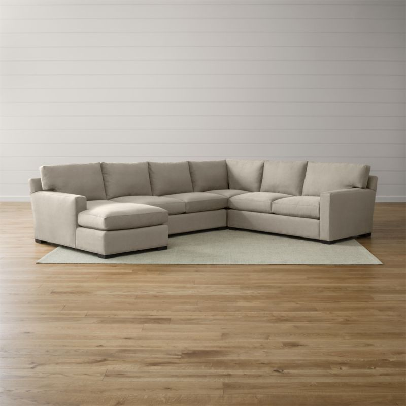 Bring Axis home and watch life revolve around it. Upholstered in a high-performance fabric that's pet, kid, and family friendly, this collection offers exceptional durability for family rooms and casual living rooms—and the versatility to customize your ideal sectional. This 4-piece sectional is comprised of the right arm apartment sofa, loveseat, left arm chaise and corner. <NEWTAG/><ul><li>Frames are benchmade with certified sustainable hardwood that's kiln-dried to prevent warping</li><li>Flexolator spring suspension systems</li><li>Soy-based polyfoam seat cushions wrapped in fiber-down blend and encased in downproof ticking</li><li>Fiber-down back cushions encased in downproof ticking</li><li>Hardwood legs stained with a rich brown finish</li><li>Made in North Carolina, USA of domestic and imported materials</li></ul><br />