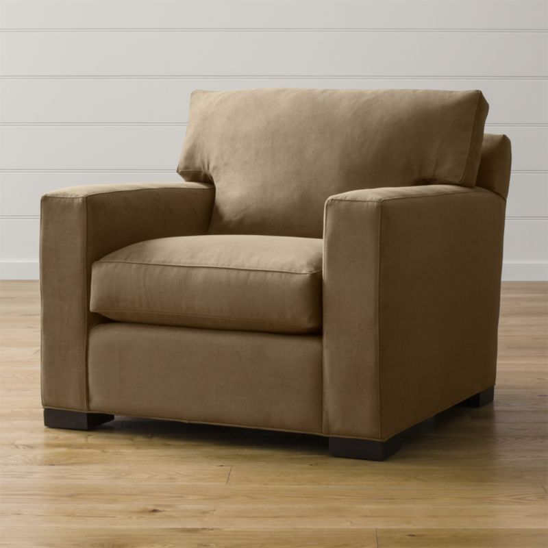 Bring Axis home and watch life revolve around it. Upholstered in a high-performance fabric that's pet, kid, and family friendly, this oversized chair offers exceptional durability for family rooms and casual living rooms. <NEWTAG/><ul><li>Frame is benchmade with certified sustainable hardwood that's kiln-dried to prevent warping</li><li>Flexolator spring suspension system</li><li>Soy-based polyfoam seat cushion wrapped in fiber-down blend and encased in downproof ticking</li><li>Fiber-down back cushion encased in downproof ticking</li><li>Hardwood legs stained with a rich brown finish</li><li>Made in North Carolina, USA of domestic and imported materials</li></ul><br />