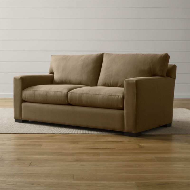 """Bring Axis home and watch life revolve around it. Upholstered in a high-performance fabric that's pet, kid, and family friendly, this full sleeper sofa offers laid-back comfort in family rooms, casual living rooms and guest rooms. <NEWTAG/><ul><li>Frame is benchmade with certified sustainable hardwood that's kiln-dried to prevent warping</li><li>Soy-based polyfoam seat cushion wrapped in fiber-down blend and encased in downproof ticking</li><li>Fiber-down back cushion encased in downproof ticking</li><li>Bi-fold 5½"""" innerspring mattress with quilted top pad</li><li>Sleeper mechanism features an anti-tip safety feature, low-profile support system and locking, tilt-up headrest</li><li>Hardwood legs stained with a rich brown finish</li><li>Made in North Carolina, USA of domestic and imported materials</li></ul><br />"""
