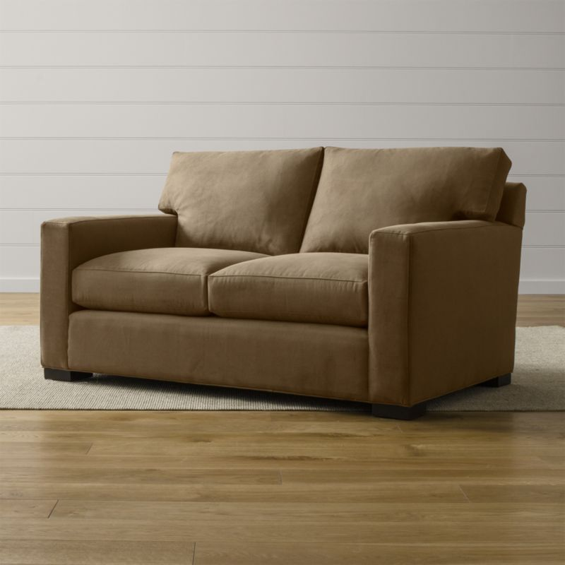 Bring Axis home and watch life revolve around it. Upholstered in a high-performance fabric that's pet, kid, and family friendly, this loveseat offers exceptional durability for family rooms and casual living rooms. <NEWTAG/><ul><li>Frame is benchmade with certified sustainable hardwood that's kiln-dried to prevent warping</li><li>Flexolator spring suspension system</li><li>Soy-based polyfoam seat cushions wrapped in fiber-down blend and encased in downproof ticking</li><li>Fiber-down back cushions encased in downproof ticking</li><li>Hardwood legs stained with a rich brown finish</li><li>Made in North Carolina, USA of domestic and imported materials</li></ul><br />