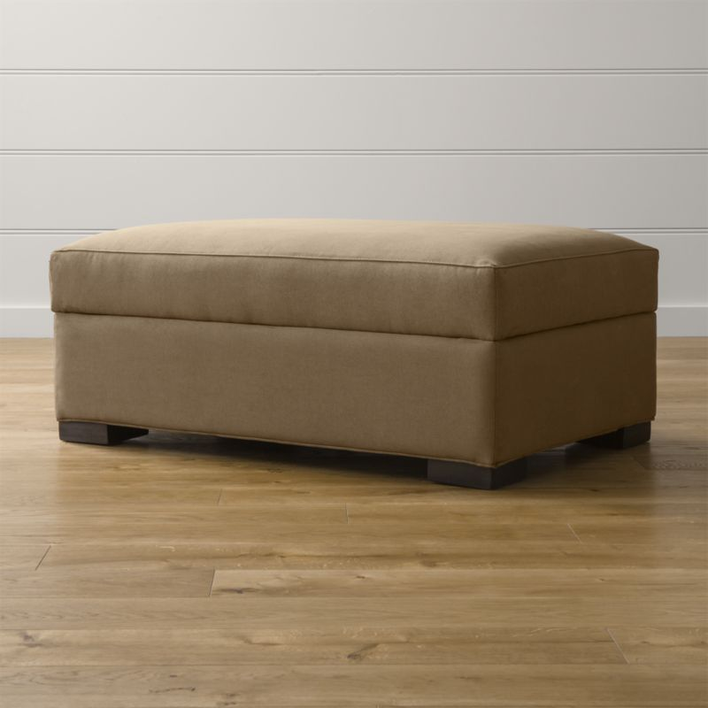 Bring Axis home and watch life revolve around it. Upholstered in a high-performance fabric that's pet, kid, and family friendly, this storage ottoman offers exceptional durability for family rooms and casual living rooms. Not surprisingly, Axis has been a customer favorite for more than a decade. The Axis II Storage Ottoman is a Crate and Barrel exclusive.<br /><br /><NEWTAG/><ul><li>Frame is benchmade with certified sustainable hardwood that's kiln-dried to prevent warping</li><li>Flexolator spring suspension system</li><li>Soy-based polyfoam seat cushion wrapped in fiber-down blend and encased in downproof ticking</li><li>Spring-assisted hinged lid locks open for easy access</li><li>Hardwood legs stained with a rich brown finish</li><li>Made in North Carolina, USA of domestic and imported materials</li></ul><br />