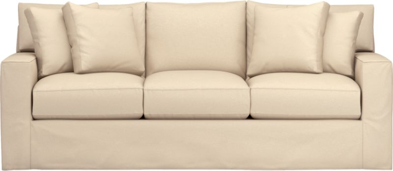 "Snug-fitting slipcovers hug Axis's deep and roomy contours, tailor-made with sleek floor-length skirt and crisp topstitching.<br /><br />Additional <a href=""http://crateandbarrel.custhelp.com/cgi-bin/crateandbarrel.cfg/php/enduser/crate_answer.php?popup=-1&p_faqid=125&p_sid=DMUxFvPi"">slipcovers</a> available through stores featuring our Furniture Collection.<br /><br /><NEWTAG/>After you place your order, we will send a fabric swatch via next day air for your final approval. We will contact you to verify both your receipt and approval of the fabric swatch before finalizing your order.<br /><ul><li>Machine washable</li><li>Topstitching detail</li><li>See additional frame options below</li><li>Made in North Carolina, USA</li></ul>"