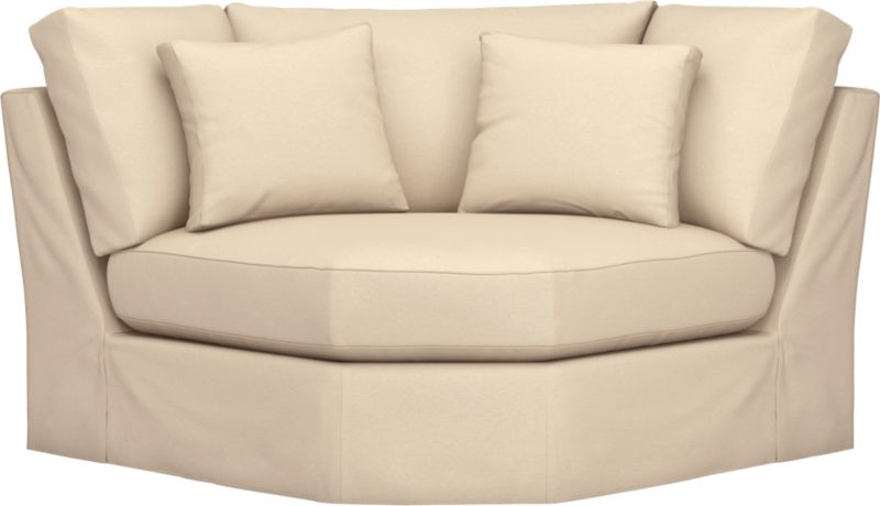"Snug-fitting slipcovers hug Axis's deep and roomy contours, tailor-made with sleek floor-length skirt and crisp topstitching.<br /><br />Additional <a href=""http://crateandbarrel.custhelp.com/cgi-bin/crateandbarrel.cfg/php/enduser/crate_answer.php?popup=-1&p_faqid=125&p_sid=DMUxFvPi"">slipcovers</a> available through stores featuring our Furniture Collection.<br /><br />After you place your order, we will send a fabric swatch via next day air for your final approval. We will contact you to verify both your receipt and approval of the fabric swatch before finalizing your order.<br /><br /><NEWTAG/><ul><li>Machine washable</li><li>Topstitching detail</li><li>See additional frame options below</li><li>Made in North Carolina, USA of domestic and imported materials</li></ul>"
