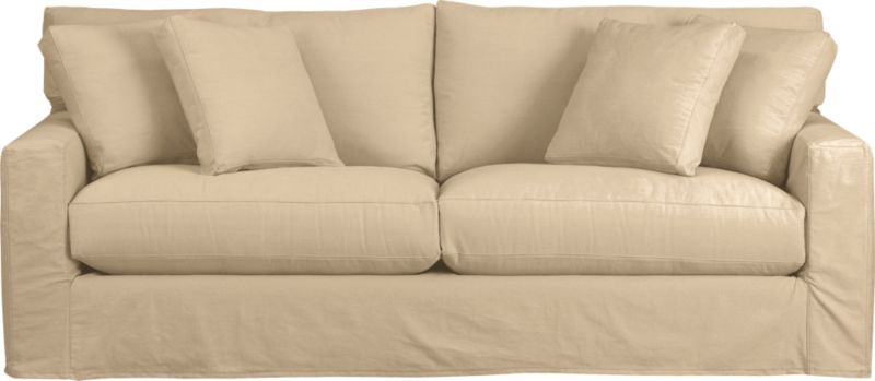 """Snug-fitting slipcovers hug Axis's deep and roomy contours, tailor-made with sleek floor-length skirt and crisp topstitching.<br /><br />Additional <a href=""""http://crateandbarrel.custhelp.com/cgi-bin/crateandbarrel.cfg/php/enduser/crate_answer.php?popup=-1&p_faqid=125&p_sid=DMUxFvPi"""">slipcovers</a> available through stores featuring our Furniture Collection.<br /><br />After you place your order, we will send a fabric swatch via next day air for your final approval. We will contact you to verify both your receipt and approval of the fabric swatch before finalizing your order.<br /><br /><NEWTAG/><ul><li>Machine washable</li><li>Topstitching detail</li><li>See additional frame options below</li><li>Made in North Carolina, USA of domestic and imported materials</li></ul>"""