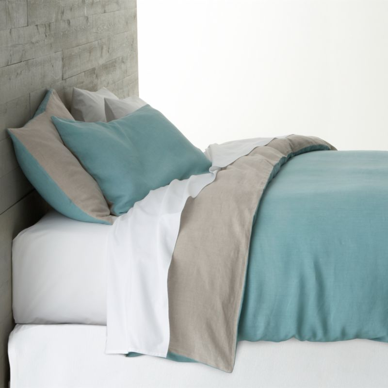 Serene blue and natural team up in the soft sophistication of two-toned bedding, woven of 100% linen. Naturally soft linen is stonewashed for exceptional comfort and relaxed feel and will soften and become more lustrous with each wash. Blue duvet cover reverses to natural and has zipper closure and interior fabric ties to hold the insert in place. Duvet inserts also available.<br /><br /><NEWTAG/><ul><li>100% linen</li><li>Machine wash cold, tumble dry low; iron damp</li><li>Made in India</li></ul>