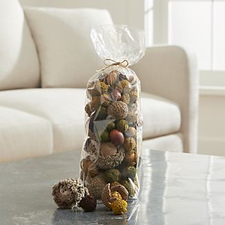 Large-sized acorns scatter autumnal charm over the holiday table or clustered with dried botanicals and seasonal gourds in a vase or low bowl.