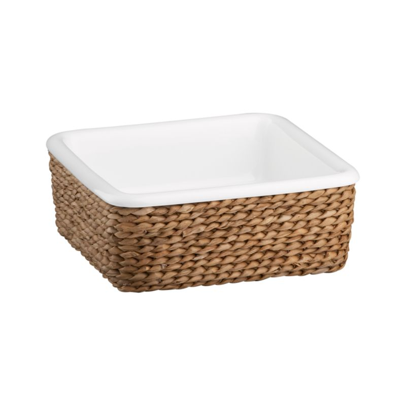 A beautiful serving solution nests an oven-to-table white porcelain square in a rustic handwoven fiber basket. Decorative and functional, the basket serves as a trivet to protect tables and countertops, or can be used separately for breads and rolls. Perfect for passing hot dishes at the table.<br /><br /><NEWTAG/><ul><li>High-fired porcelain baker</li><li>All natural bankuang fiber basket</li><li>Basket is foodsafe</li><li>Dishwasher-, freezer-, microwave- and oven-safe</li><li>Clean basket with a dry cloth only</li></ul>