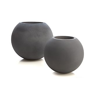 Earth-friendly globe planter does a world of good, cast of naturally derived mineral compounds, sea salt, sand and fiber and manufactured with low emissions and minimal energy use. Grey-toned planter makes the rounds in a textured organic finish and can withstand all kinds of weather. Post-use this green-minded pot will biodegrade.Mineral compounds, sea salt, sand and fiberZero VOC emissionsDrainage holeFrost-, heat-, mold-, mildew- and termite-resistantMade in China