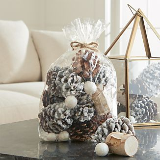 Composed of shimmery ball fruit, flocked pinecones and mini birch logs, this seasonal potpourri wafts the fresh scent of balsam pine throughout the holiday home.