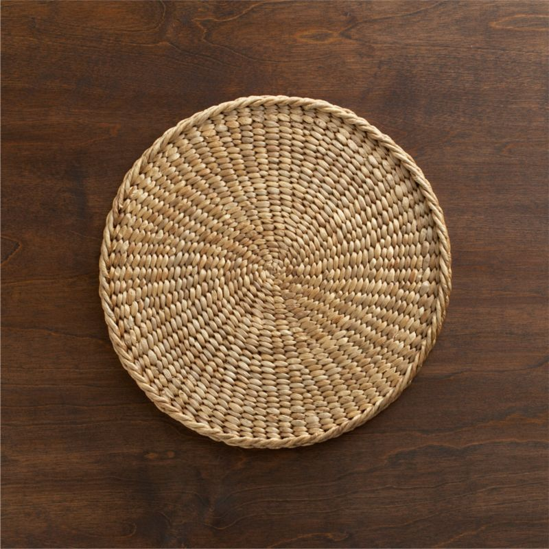 Rustic round is handwoven from sustainable water hyacinth reeds, lending sophisticated, organic appeal to the indoor or outdoor table.<br /><br /><NEWTAG/><ul><li>Handcrafted</li><li>Water hyacinth</li><li>Made in Indonesia</li></ul>