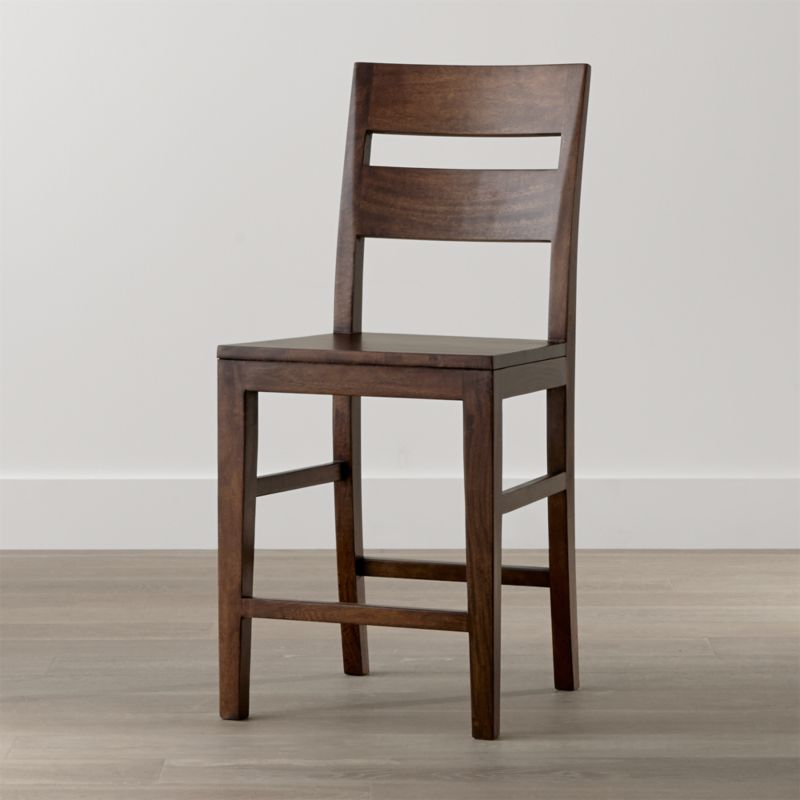 The perfect seating option for the Basque high dining table, this counter stool recalls the simple, rustic character of a European farmhouse antique. With a strong yet comfortable presence, the generously proportioned bar stool is designed with a tall, modified double-slat back and deep seat. <NEWTAG/><ul><li>Sustainable solid mango wood</li><li>Rich honey stain with lacquer finish</li><li>Hand-planed wooden planks</li><li>Peg detailing</li><li>Naturally occurring grain and knots</li><li>Sized for the Basque high dining table and counters</li><li>Made in Indonesia</li></ul><br />