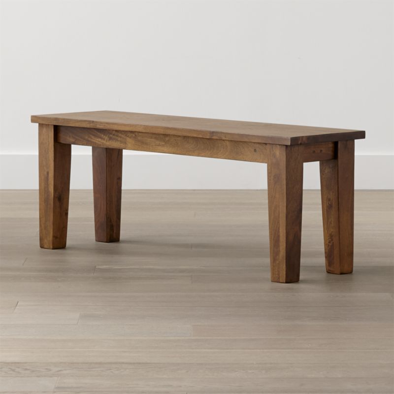 """Simply rustic with the heft and character of a European farmhouse antique, the Basque 48"""" bench is a casual option for seating 2 at the Basque 65"""" dining table. Each compact bench is handcrafted entirely using hand-planed wooden planks of sustainable solid mango wood with authentic peg detailing. <NEWTAG/><ul><li>Sustainable solid mango wood</li><li>Rich honey stain with lacquer and wax finish</li><li>Hand-planed wooden planks</li><li>Peg detailing</li><li>Naturally occurring grain and knots</li><li>Seats 2</li><li>Made in India</li></ul><br /><br />"""