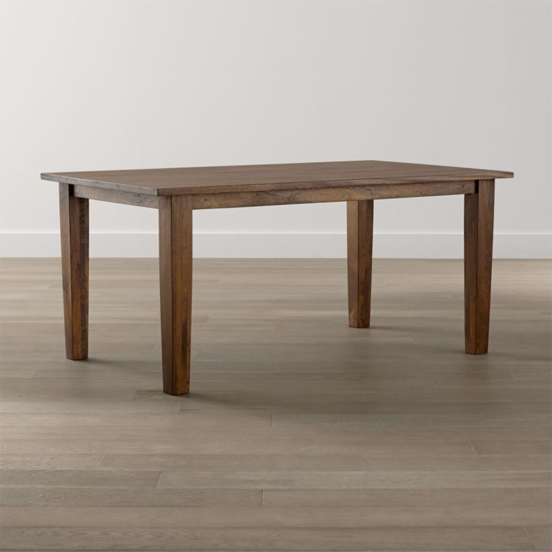 "Simple and rustic, the Basque 65"" dining table displays the heft and character of a European farmhouse antique. With substantial legs and hand-planed wooden planks finished with authentic peg detailing, this moderately scaled 6-seat table is handcrafted of sustainable solid mango wood with a rich honey stain and lacquer finish. <NEWTAG/><ul><li>Sustainable solid mango wood</li><li>Rich honey stain with lacquer and wax finish</li><li>Hand-planed wooden planks</li><li>Peg detailing</li><li>Naturally occurring grain and knots</li><li>Seats 6</li><li>Made in India</li></ul><br />"