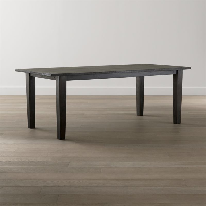"""Our Basque dining collection recalls the heft and character of European farmhouse antiques. Simple and rustic, the mid-sized 82"""" dining table's bold proportions (scaled to seat 8) are enhanced with a java brown finish. <NEWTAG/><ul><li>Sustainable solid mango wood</li><li>Java brown stain with lacquer and wax finish</li><li>Hand-planed wooden planks</li><li>Peg detailing</li><li>Naturally occurring grain and knots</li><li>Seats 8</li><li>Made in India</li></ul>"""