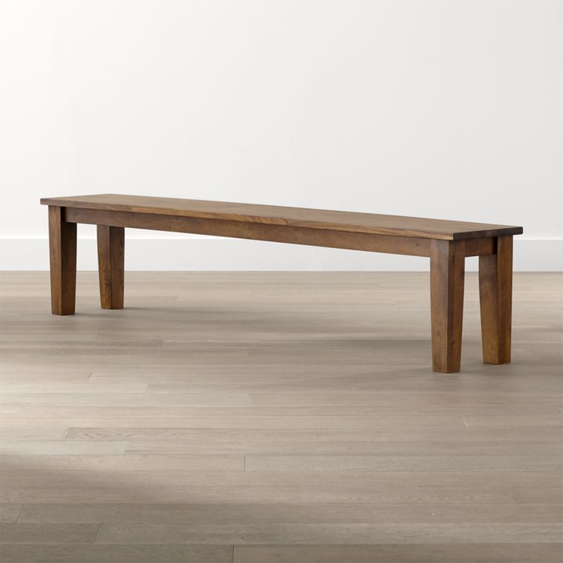 """Simple and rustic, the Basque 84"""" bench pulls up to the 104"""" dining table to seat 4 on 1 side. Displaying the heft and character of a European farmhouse antique, this bench is handcrafted entirely using hand-planed wooden planks of sustainable solid mango wood with authentic peg detailing. <NEWTAG/><ul><li>Sustainable solid mango wood</li><li>Rich honey stain with lacquer and wax finish</li><li>Hand-planed wooden planks</li><li>Peg detailing</li><li>Naturally occurring grain and knots</li><li>Seats 4</li><li>Made in India</li></ul><br /><br />"""