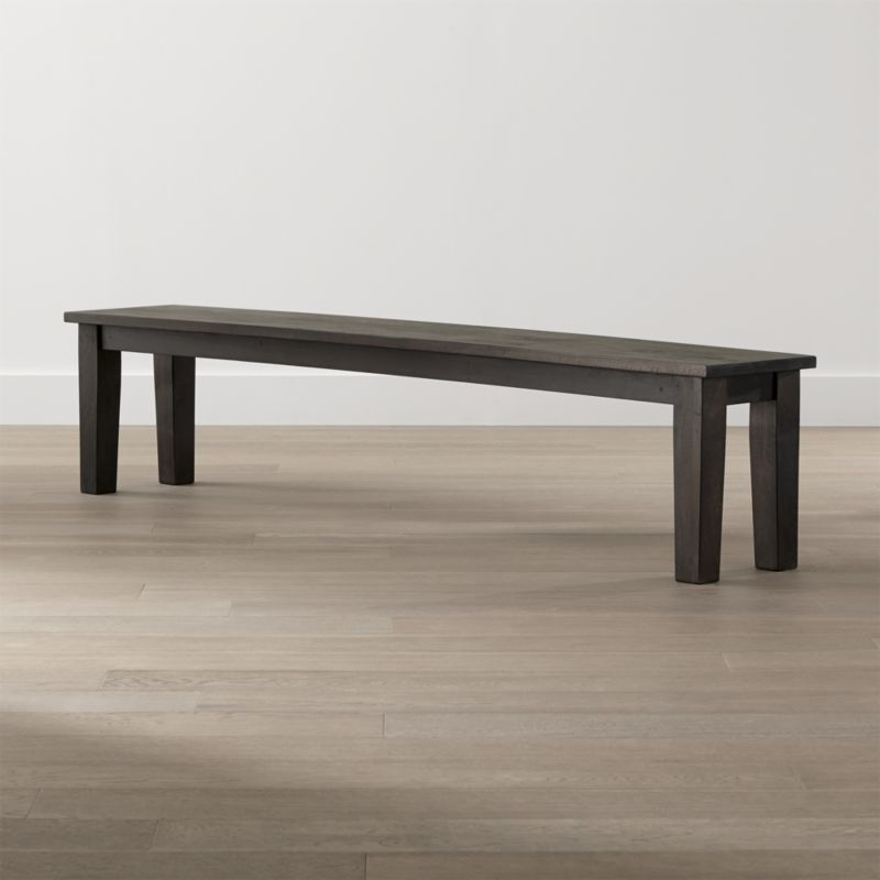 """The bold proportions of this 84"""" bench are designed to stand up to the grand scale of the Basque 104"""" dining table. Seating up to 4, this simple, rustic seating option brings home the heft and rustic character of a European farmhouse antique. <NEWTAG/><ul><li>Sustainable solid mango wood</li><li>Java brown stain with lacquer and wax finish</li><li>Hand-planed wooden planks</li><li>Peg detailing</li><li>Naturally occurring grain and knots</li><li>Seats 4</li><li>Made in India</li></ul><br /><br />"""