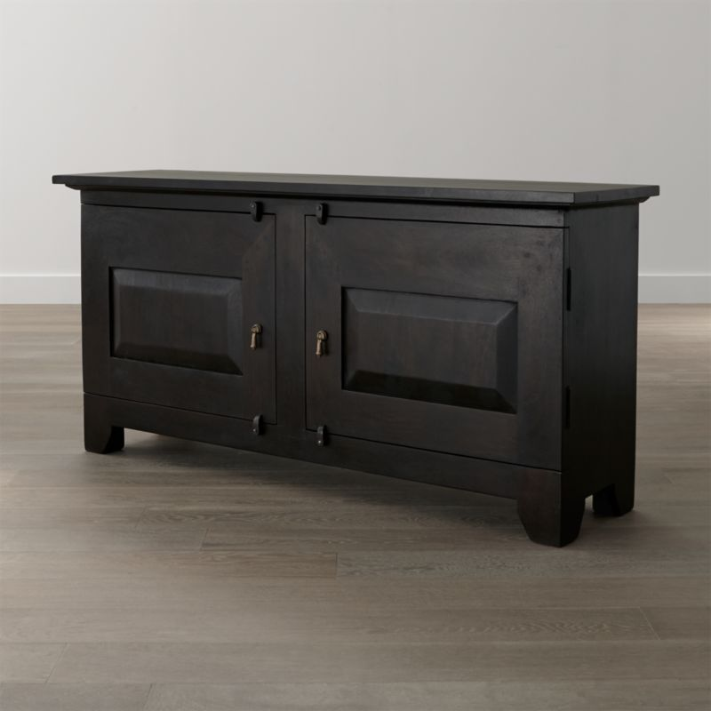 The boldly scaled Basque buffet has a strong presence with the heft and character of a European farmhouse antique. Handcrafted from hand-planed planks of sustainable solid mango wood, the simply rustic effect is enhanced by authentic peg detailing, dangling cast brass pulls and rustic hasp closures. <NEWTAG/><ul><li>Sustainable solid mango wood</li><li>Java brown stain with lacquer and wax finish</li><li>Hand-planed wooden planks</li><li>Peg detailing</li><li>Naturally occurring grain and knots</li><li>2 fixed shelves</li><li>Made in India</li></ul><br />