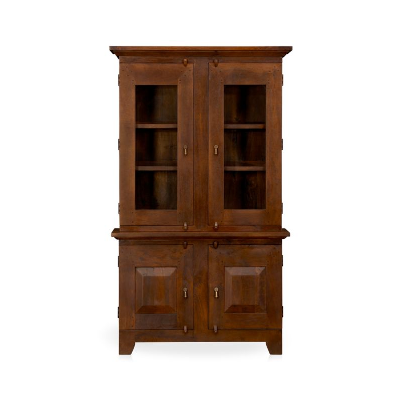 Hutch top with glass doors has rustic, handcrafted detailing and antique appeal scaled for smaller spaces. The rich honey finish is waxed to a soft sheen.<br /><br /><NEWTAG/><ul><li>Handcrafted</li><li>Sustainable, kiln-dried solid mango wood</li><li>Peg detailing</li><li>Naturally occurring grain and knots</li><li>Rich honey finish</li><li>Four fixed shelves: two per side</li><li>Dangling, cast brass pulls and rustic hasp closures</li></ul>