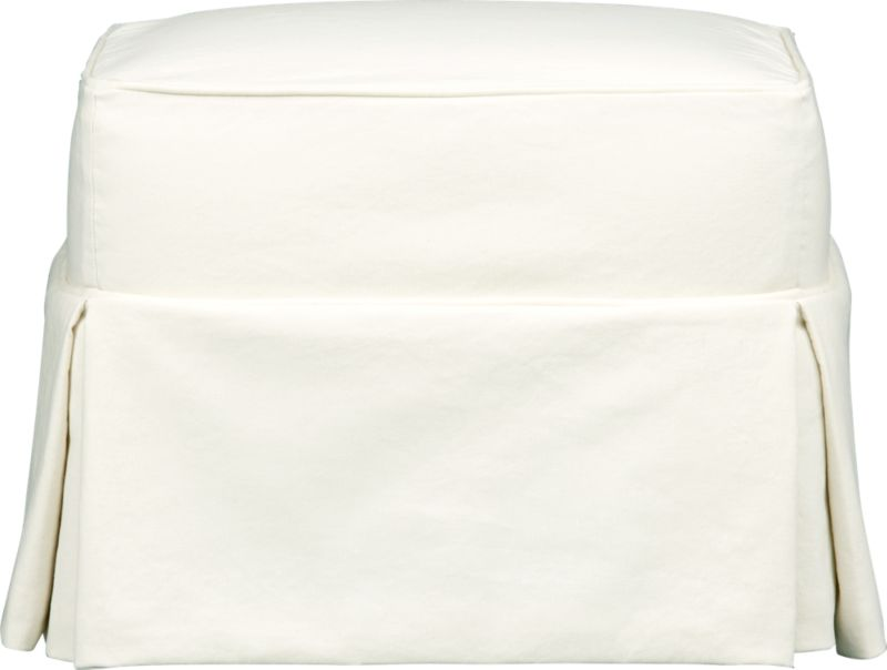 "Machine-washable skirted slipcover tailored for Bayside Ottoman takes on everyday living.<br /><br />Additional <a href=""http://crateandbarrel.custhelp.com/cgi-bin/crateandbarrel.cfg/php/enduser/crate_answer.php?popup=-1&p_faqid=125&p_sid=DMUxFvPi"">slipcovers</a> available through stores featuring our Furniture Collection.<br /><br />After you place your order, we will send a fabric swatch via next day air for your final approval. We will contact you to verify both your receipt and approval of the fabric swatch before finalizing your order.<br /><br /><NEWTAG/><ul><li>89% cotton, 11% polyester</li><li>Machine washable</li><li>Made in North Carolina, USA of domestic and imported materials</li></ul><br />"