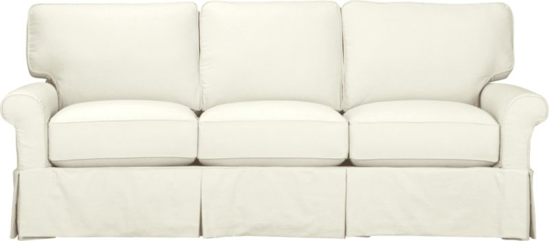 "Machine-washable skirted slipcover tailored for Bayside Three-Seat Sofa takes on everyday living.<br /><br />Additional <a href=""http://crateandbarrel.custhelp.com/cgi-bin/crateandbarrel.cfg/php/enduser/crate_answer.php?popup=-1&p_faqid=125&p_sid=DMUxFvPi"">slipcovers</a> available through stores featuring our Furniture Collection.<br /><br />After you place your order, we will send a fabric swatch via next day air for your final approval. We will contact you to verify both your receipt and approval of the fabric swatch before finalizing your order.<br /><br /><NEWTAG/><ul><li>89% cotton, 11% polyester</li><li>Machine washable</li><li>Made in North Carolina, USA of domestic and imported materials</li></ul><br />"