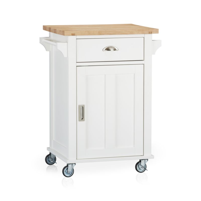 Instantly expand your kitchen's work surface and storage area with a contemporary cottage-inspired cart. Beautifully grained plank top is crafted from sustainable solid rubberwood with an oil finish. Solid wood veneered base with a white lacquer finish rests on four industrial-grade casters, making it easy to move or store. Also includes the option of four sturdy tapered feet (see additional photographs). Roomy single drawer, recessed panel cabinet with one adjustable shelf, and two towel bars provide generous storage. Brushed nickel hardware.<br /><br /><NEWTAG/><ul><li>Sustainable solid rubberwood top with foodsafe oil finish</li><li>Base is low-emission engineered wood with rubberwood veneer and lacquer finish</li><li>Brushed nickel hardware</li><li>Casters and optional wood feet</li><li>Made in Thailand</li></ul>