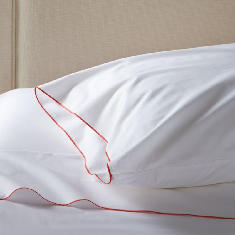 Clean, basic white bedding upgrades in soft, smooth cotton percale, beautifully contrasted with a graceful coral overlocking stitch on the flat sheet and pillow case. Generous fitted sheet pockets accommodate thicker mattresses. Set includes one flat sheet, one fitted sheet and one standard pillow case. Bed pillows also available.<br /><br /><NEWTAG/><ul><li>100% cotton percale</li><li>200-thread-count</li><li>Machine wash; tumble dry low</li><li>Made in Portugal</li></ul><br />